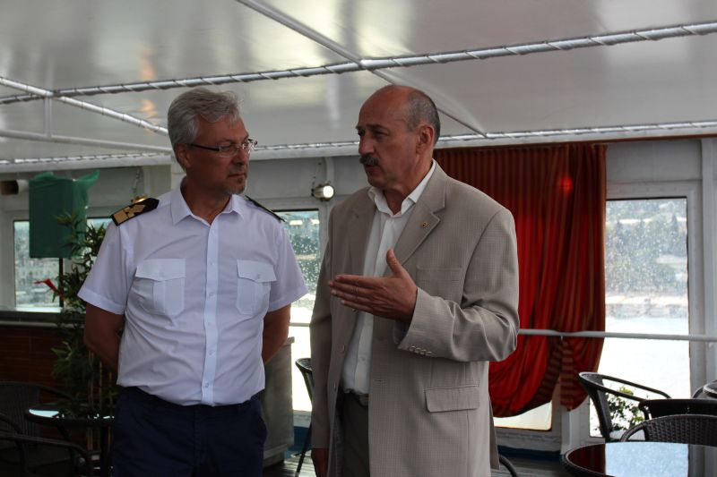 Minister of Resorts and Tourism of the Republic of Crimea Sergey Strelbitsky (right) meets with the ship's captain