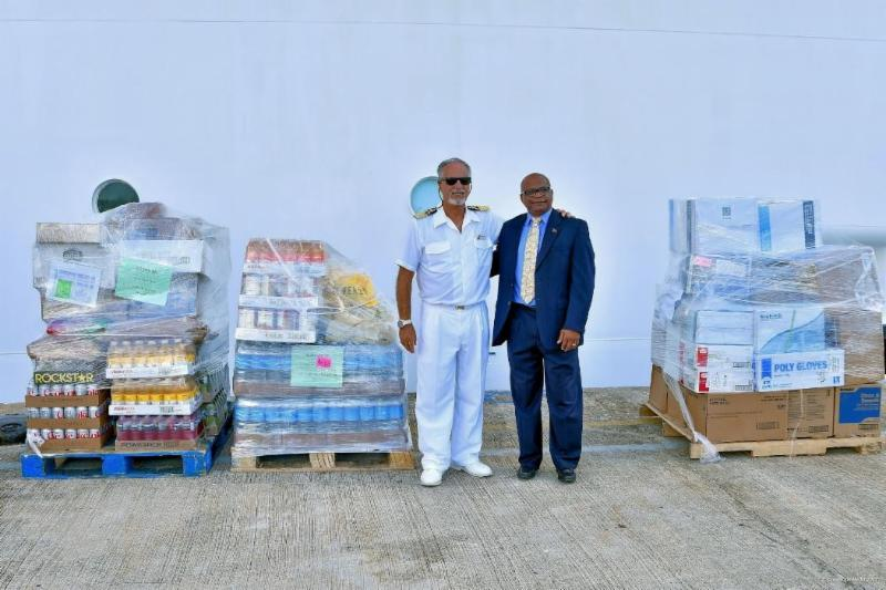 Candeloro Donato, Captain of the Carnival Fascination, with St. Kitts' Minister of Tourism, International Trade, Industry and Commerce the Hon. Mr. Lindsay F.P. Grant and relief supplies being delivered from the vessel via St. Kitts to St. Maarten, which was severely impacted by Hurricane Irma.