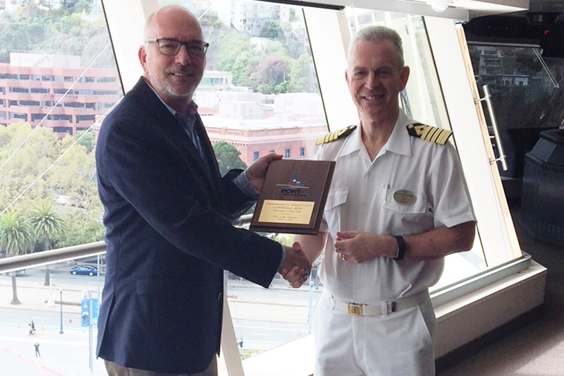 Port of San Francisco Maritime Director Peter Dailey presents a plaque to Captain Steffan Bengtsson of Norwegian Bliss.