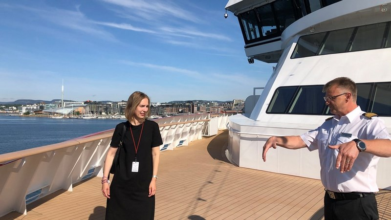 Minister of Trade and Industry, Iselin Nybo, with Captain Rune Andreassen aboard Hurtigruten's Fridtjof Nansen