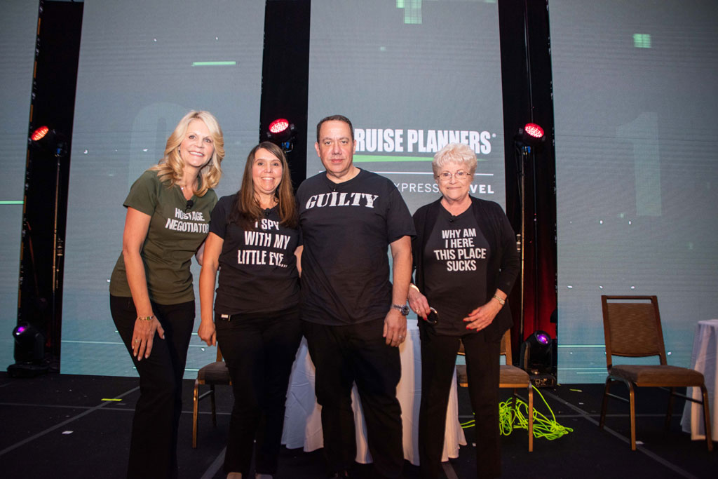 "(L-R) CEO Michelle Fee played a ""cross examiner"" with top-producing overachieversJulie Irovando, Michael Consoli and Nancy Bogert donning comical themed shirts for the educational"