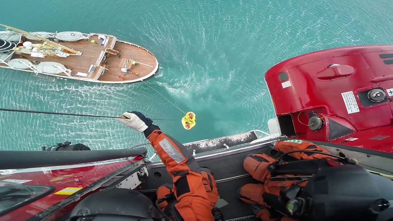 People being hoisted from vessel. Photo by Marcus Aleksander Krogtoft