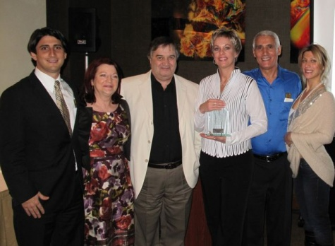 from L to R:  Gregory Luciani (President & CEO, Travelonly), Ann Luciani, Phil Egan (Vice President, Sales & Marketing), Dana Gain (Business Development Director, Carnival Cruise Lines), Patrick Luciani (Chairman, Travelonly), Nicole Luciani (Accounts & Marketing Liaison).