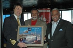 Carnival Fantasy Captain Roberto Costi (left) accepts a plaque from Mobile City Commissioner Fred Richardson (center) and Al Stokes, chief of staff of Mobile Mayor Sam Jones.