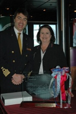 Carnival Fantasy Captain Roberto Costi (left) is presented with an etched, illuminated plaque of the Carnival Fantasy from the Port of Mobile's Operations Manager Sheila Gurganus.
