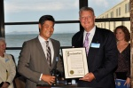 Rodney Fong (left), President of the San Francisco Port Commission presents