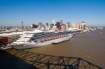 The 2,758-passenger Carnival Triumph arrived in New Orleans today – a day later than anticipated due to Tropical Storm Ida.