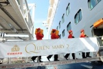 Cunard's White Star Bellmen carry cases of Veuve Clicquot champagne aboard Queen Mary 2 for Royal Wedding commemorative cocktails during the ship's Transatlantic Crossing, which embarked from New York on Thursday, 26 April.