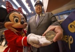 The keel laying ceremony is a significant milestone in the ship building process when the first block, or section of the ship, is lowered into the building dock and a coin is placed under the keel for good fortune.  Placing the coin was Karl Holz, President of Disney Cruise Line, assisted by Minnie Mouse.