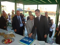 Neil Palomba (MSC's chief operating officer) cuts a cake to welcome MSC back to Tunisia