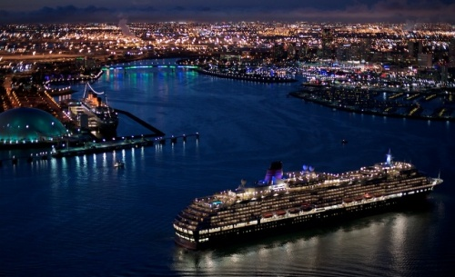 Queen Victoria met her docked sister ship Queen Mary yesterday in Long Beach, Calif. underneath a fireworks show for a Cunard Royal Rendezvous