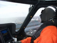 Coast Guard MH-60 Jayhawk helicopter pilot prepares to approach the cruise ship Explorer of the Seas 230 miles east of Cape Henry, Va. for a medevac of a 59-year-old women, March 11, 2011. Coast Guard Air Station Elizabeth City, N.C. responded by sending the helicopter crew and a C-130 aircrew. U.S. Coast Guard photo by Petty Officer 2nd Class Richard Fertig.