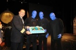 Norwegian Epic Hotel Director Denis Prguda presents a cake to the Blue Man Group.