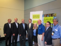 Industry leaders pose for a photo at the FCCA Conference