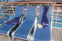 Under the new system, shipboard team members monitor sun lounge usage and if they observe a seat that contains a towel or personal belongings but appears to be unoccupied, a notification is placed on the chair indicating the current time.  If the chair remains unoccupied for 40 minutes, the contents are removed and held for the guest's safekeeping.  (photo: Cruise Industry News)