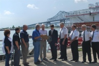 "Officials with the Port of New Orleans Cruise Division conduct a plaque exchange with American Cruise Lines executives to commemorate the inaugural cruise of the ""Queen of the Mississippi."" Pictured is (left to right) Sharon Reames, Port of New Orleans; Steven Gauthier, Port of New Orleans; Johnny Cefalu, Deputy Director of Cruise and Tourism, Port of New Orleans; Robert Jumonville, Port of New Orleans Director of Cruise and Tourism; Charles Robertson, Chairman & CEO of American Cruise Lines; Paul Taiclet, VP & Hotel Operations - ACL; Capt. John Ayer; Capt. Kenny Williams; Capt. Mike Snyler; and Capt. John Keereweer."