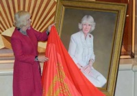 HRH The Duchess of Cornwall unveils a specially commissioned portrait of her by Royal artist Richard Stone during fifth anniversary celebrations aboard Cunard Line's Queen Victoria on 13 December 2012 in Southampton, England.