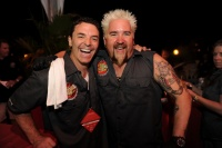 Fieri is pictured at the festivities with Carnival's Senior Vice President of Guest Operations Mark Tamis.