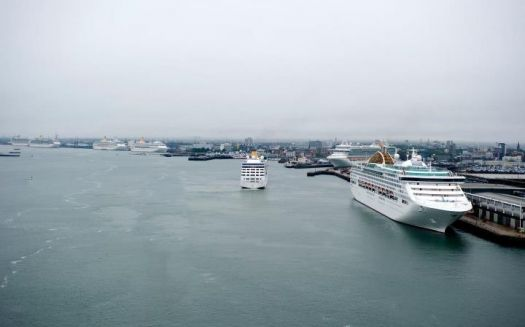 Photo of all seven P&O ships, Adonia maneuvering into position here.
