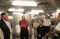 Senior Marine Inspector/Lead Instructor Brad Schoenwald going over galley details with the group.