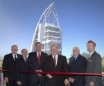Pictured above from left are Canaveral Port Authority Commissioners Jerry Allender (Secretary/Treasurer); Frank Sullivan; Tom Weinberg (Vice Chairman); Bruce Deardoff (Chairman) and Joe Matheny, along with Port Canaveral CEO Stan Payne. In the background is a rendering of the $21 million, seven-story Welcome Center scheduled to be completed by July 2013. The ribbon-cutting officially opens the public viewing platform that will allow visitors to monitor the progress of construction.