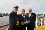 "f.l.t.r.: Port Captain Jörg Pollmann (Hamburg Port Authority); Senator Frank Horch, Ministry of Economic Affairs, Transport and Innovation; Michael Ungerer, Vice-President of AIDA Cruises: Senator Frank Horch was presented with the first ship's model of the ""AIDAmar""."