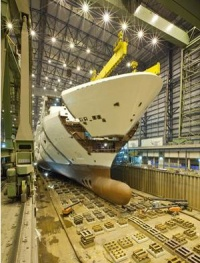 Norwegian Breakaway, under construction at Meyer Werft in Papenburg, Germany achieved another milestone on Wednesday morning when the ship's bow was lowered into place.