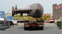 Replacement pod in Europe heading for a cargo ship.