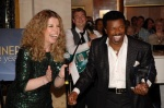 Cruise Director Lisa Ball presents singer Tony Tillman with the award for 2012 Entertainer of the Year.