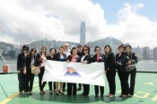 The educators from Sripatum University posed against the stunning backdrop of Victoria Harbour onboard Star Pisces.