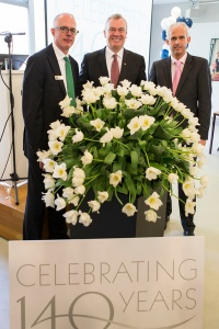 "In celebration of its 140th anniversary, an official christening of the new Holland America Line ""Signature"" tulip took place in the Netherlands on Friday, April 19, at the world-famous Keukenhof Gardens. Here, company employees are left to right: Joe Slattery, vice president, international sales, marketing and planning; Stein Kruse, president and CEO; and Nico Bleichrodt, senior director, sales, Netherlands."