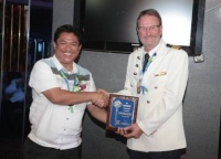 "At the welcome ceremony, Honorable Jupiter Gallenero, Sangunian Bayan Member, Municipality of Malay (left) presented the ""Key to the City"" to Captain Carl J. Nilermark of SuperStar Aquarius (right)."