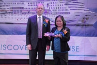Ms. Maria Corazon Jorda-Apo, Director for Market Development Group of the Department of Tourism (right) received a model crystal ship from Mr. Michael Hackman, Senior Vice President and Country Head—Philippines, Star Cruises (left).