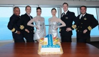 Norwegian Breakaway's Godmothers, The Rockettes (center), along with the ship's Captain Hakan Svedung (center right) and Four Stripe officers (from L to R, Hotel Director Prem  Kainikkara, Staff Captain Matko Candrlic and Chief Engineer Zoran Posa) mark one year of  sailing from Manhattan