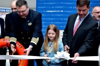 Norwegian Dawn Captain Teo Grbic, Condon School student Sinead Mulligan and Boston Mayor Martin Walsh officially open Cruiseport Boston's 2014 season today during a Ribbon  Cutting ceremony today.