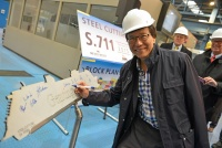 Tan Sri Lim Kok Thay, Chairman and Chief Executive Officer of Genting Hong Kong signing on the first steel-cut of Genting World during the first steel-cutting ceremony in Papenburg, Germany on 9 Feb 2015.