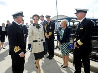 Queen Mary 2 Captain Kevin Oprey, left, greets HRH Princess Anne, patron of the National Museum of the Royal Navy (NMRN), at the Brooklyn Cruise Terminal in New York.  Joining them are Richard Meadows, president, Cunard North America, Admiral of the Fleet the Lord Boyce, Cheryl Oprey and the ship's Hotel Manager Robert Howie. (Photo by Diane Bondareff/AP Images for Cunard)