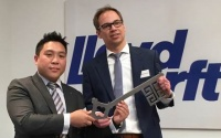 Mr. Hui Lim, Executive Director and Chief Information Officer, Genting Hong Kong presents the symbolic key to the new Lloyd Werft Group Design Centre to Mr. Benedikt Dreymann, Head of Design & Engineering, Lloyd Werft