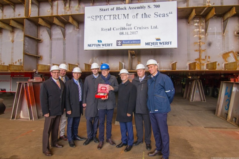 Today marked an important milestone in the development of Royal Caribbean's newest ship, Spectrum of the Seas, when her keel was lowered into place at the Neptun Werft shipyard in Rostock, Germany. Present at the event were Thomas Murken of DNV GL, Thomas Weigend of Meyer Werft, Carsten Pengel of Meyer Werft, Mathias Kopitzki of Neptun Yard, Stephan Schnees of Meyer Werft, Raimon Strunk of Neptun Yard, Kevin Douglas of Royal Caribbean Cruises Ltd., and Sebastian Brunel of Royal Caribbean Cruises Ltd.