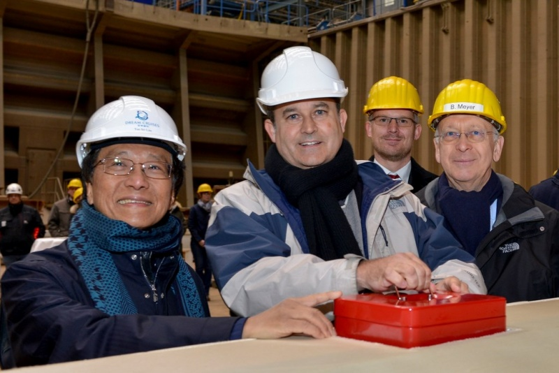 (L to R)  Tan Sri Lim Kok Thay (Chairman and CEO, Genting Hong Kong), Thatcher Brown (President, Dream Cruises), Henning Stellermann (Project Manager, Meyer Werft) and Bernard Meyer (CEO, Meyer Werft) with the traditional lucky coins