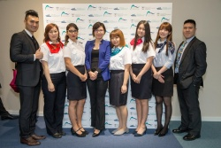 Miss Kara Yeung, Executive Director (fourth from left), with her team at the soft opening of the HKCYIA office