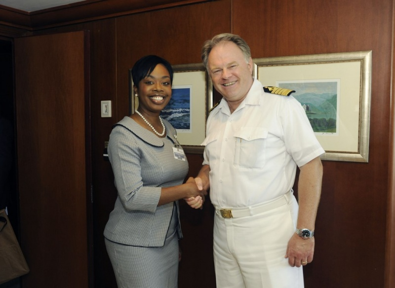 Captain Birger Vorland (right) was greeted by Secretary for Tourism Nadine Stewart-Phillips (left)