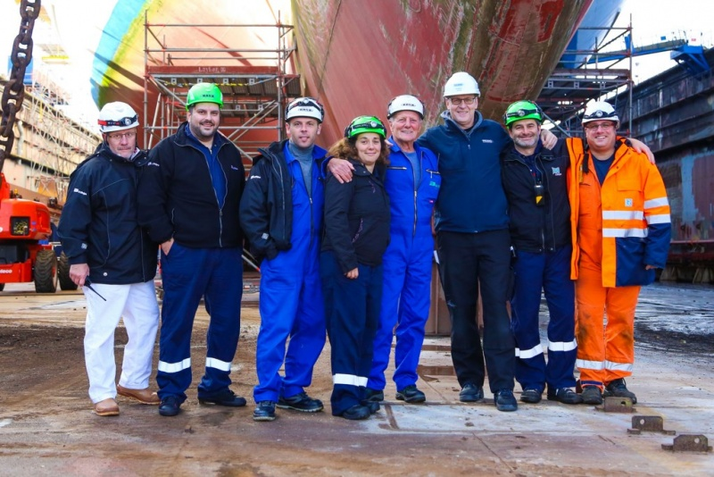Captain Jens Thorn with Artania's shipyard team in drydock