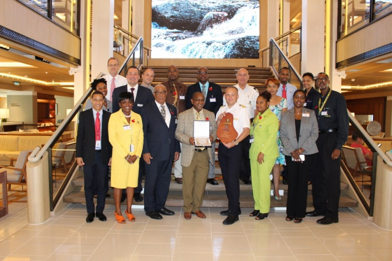 : (Third from left) Deputy Chairman of Barbados Port Inc. Captain George Fergusson; Chairman of the Barbados Tourism Marketing Inc. Alvin Jemmott and Captain of Viking Sea, Bent Gangdal join other persons onboard the ship for the inaugural ceremony to take a photo in the atrium.