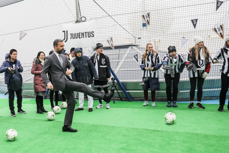 Mario Zanetti, CEO of Carnival China, interacts with guests on the world's first football court at sea
