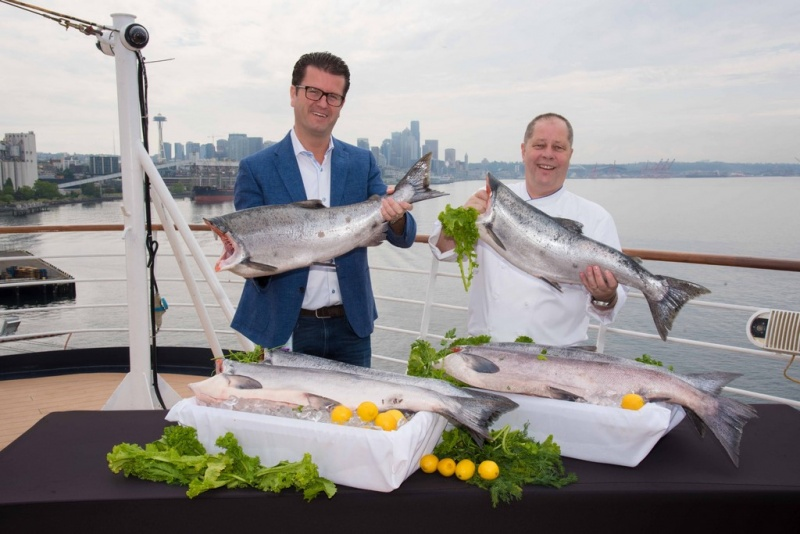 Frits Van Der Werff, vice president, food and beverage experience, and Robert Schuman, fleet executive chef, aboard the Eurodam with Copper River king salmon