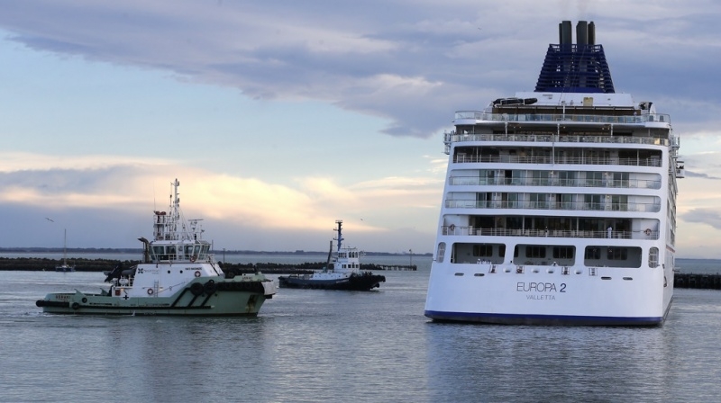 The six-star luxury ship Europa 2 navigates, with the help of tugboats, into Primeport Timaru.