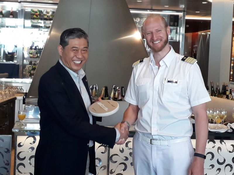 Mein Schiff 4 Captain Naneder Sebastian (right) and Piraeus' Captain Weng Lin (left), Deputy CEO of the port authority, made the placque exchange aboard.