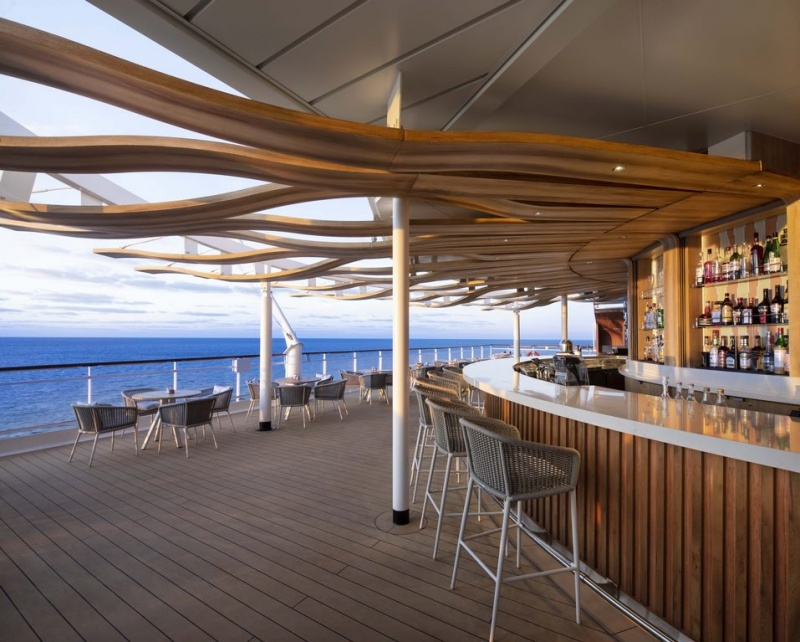 "In collaboration with renowned New York hospitality design firm BG Studio International, a longtime partner of Celebrity Cruises, the brand revealed a ""revolutionized"" Sunset Bar."