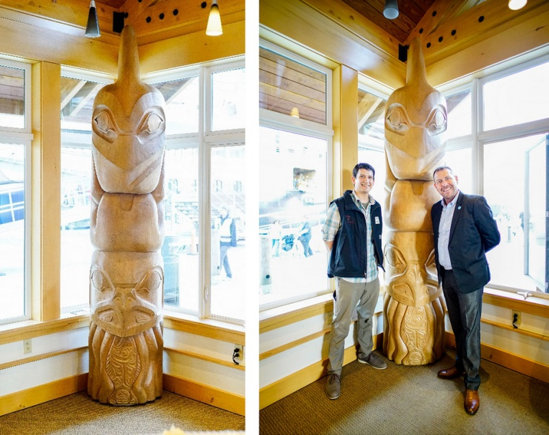 Left: The Masters of the Sea totem pole carved by local carver Kelly White; Right: Local carver, Kelly White (left), and Princess Cruises Manager of Regional Programs and Entertainment Experience, Christopher Nicholson (right)